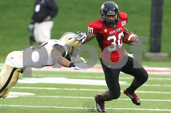 Kyle Bursaw – kbursaw@shawmedia.com<br /> <br /> Northern Illinois running back Akeem Daniels (30) stiff arms Army defensive back Josh Jackson (14) during the first quarter at Huskie Stadium in DeKalb, Ill. on Saturday, Sept. 3, 2011.