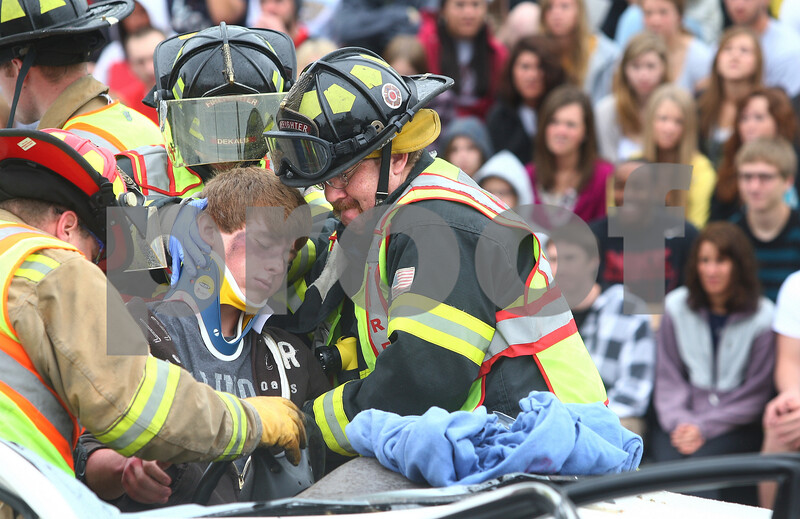 Kyle Bursaw – kbursaw@daily-chronicle.com<br /> <br /> During a simulation for Sycamore high school students to show the devastation of drinking and driving. After using the Jaws of Life to remove the roof of the vehicle emergency responders extract Sycamore student Mitch Nelson and place him onto a stretcher on Wednesday, May 18, 2011.