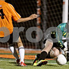 Rob Winner – rwinner@shawmedia.com<br /> <br /> Sycamore goalkeeper Ethan Horlock makes a save ahead of DeKalb's Johnny Franco during the first half in DeKalb on Tuesday, Sept. 20, 2011.