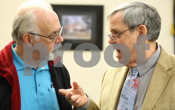Kyle Bursaw – kbursaw@shawmedia.com<br /> <br /> Jim Lockard (left), a member of AFSCME Dekalb County Subchapter 70, speaks with chapter president Earl Shumaker about his trip to Springfield on Wednesday before their meeting at the Lincoln Inn in DeKalb, Ill. on Thursday, Oct. 27, 2011.