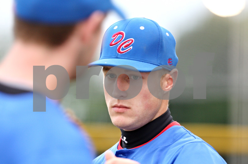 Rob Winner – rwinner@daily-chronicle.com<br /> <br /> Jacob Lueneburg, of the DeKalb County Liners, greets his teammates between innings during a game in Sycamore, Ill. on Thursday, June 23, 2011.