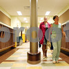 Rob Winner – rwinner@daily-chronicle.com<br /> <br /> Assistant superintendent Kari Cremascoli (left) and school board member Nina Fontana walk through the kindergarten wing of Founders Elementary in DeKalb on Monday afternoon.
