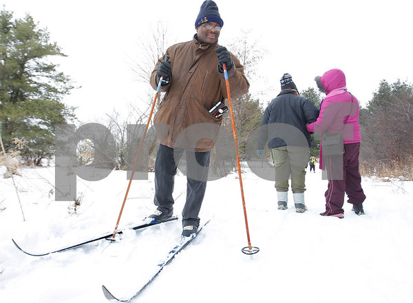 Kyle Bursaw – kbursaw@daily-chronicle.com<br /> <br /> Pierre Bance speaks with a visually impaired hiker and her guide while he cross-country skis in the other direction on a trail at Shabbona Lake State Park during the Lion's annual Ski-for-Sight event on Saturday, Jan. 29, 2011. Bance's sighted guide was Jerry Foster, not pictured.