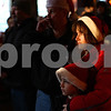 Kyle Bursaw – kbursaw@shawmedia.com<br /> <br /> Christi Crome and her son Brayden, 9, listen as they and other Goodfellows of DeKalb-Sycamore volunteers are given instructions for the gift distribution inside of Blumen Gardens in Sycamore, Ill. on Saturday, Dec. 24, 2011.
