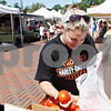 Rob Winner – rwinner@daily-chronicle.com<br /> <br /> With an envelope containing vouchers for fruit and vegetables, Sycamore resident Jenny Fischer looks over some tomatoes offered by Theis Farm Market on Thursday, Aug. 11, 2011, at the DeKalb Farmers Market. Theis Farmers Market is one of the vendors that accepts the vouchers for payment at the farmers market.