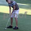 Wendy Kemp - For The Daily Chronicle<br /> Junior Kyle Buzzard lines up his shot during practice at the Sycamore Golf Club on Thursday.<br /> Sycamore 8/11/11