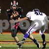 Kyle Bursaw – kbursaw@shawmedia.com<br /> <br /> DeKalb quarterback Brian Sisler makes a cut as Rochelle linebacker Kane Rodriguez attempts to tackle him in the second quarter of the game at DeKalb High School on Friday, Oct. 21, 2011.