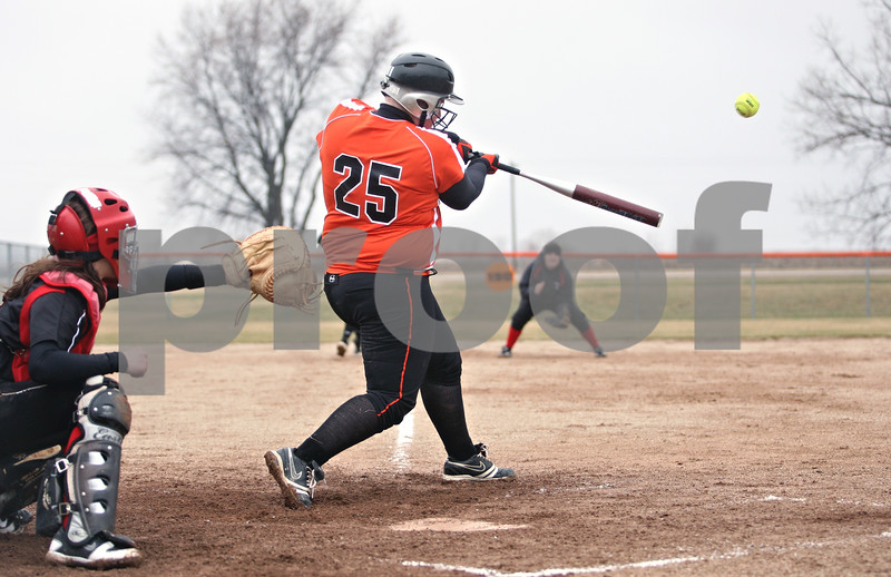Rob Winner – rwinner@daily-chronicle.com<br /> <br /> DeKalb's Vicki Von Bergen drives in two with a double during the bottom of the first inning in DeKalb, Ill., on Wednesday, March 23, 2011. DeKalb went on to defeat Indian Creek in five innings, 16-4.