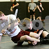 Rob Winner – rwinner@daily-chronicle.com<br /> <br /> Jake Jones (left) wrestles with teammate Doug Johnson during practice on Tuesday, Feb. 15, 2011 in DeKalb. Ill.