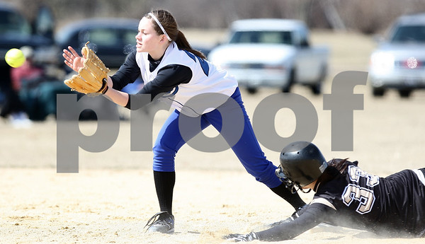 Kyle Bursaw – kbursaw@daily-chronicle.com<br /> <br /> Sycamore's Haley Salazar slides into second base just ahead of the ball Newark's Lauren Tollefson catches during the first game of a doubleheader against Newark in Sycamore, Ill. on Saturday, March 19, 2011.