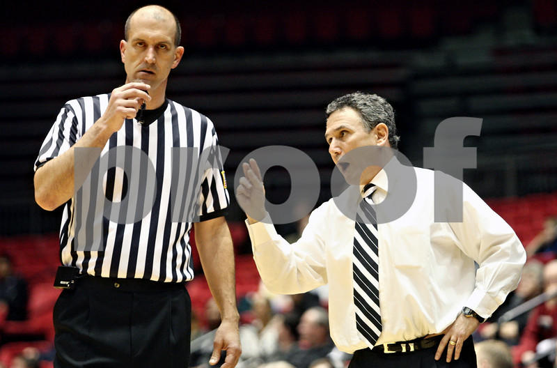 Rob Winner – rwinner@daily-chronicle.com<br /> <br /> A referee listens as Akron coach Keith Dambrot voices his concern after a play during the first half in DeKalb, Ill., on Wednesday, Jan. 26, 2011.