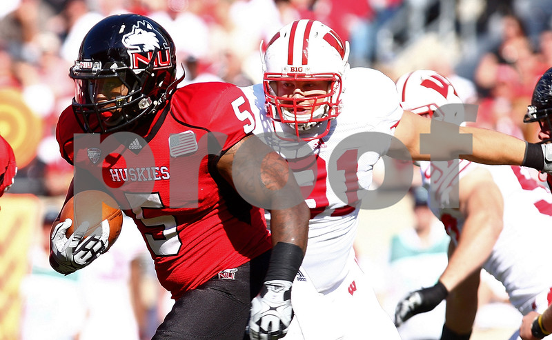 Kyle Bursaw – kbursaw@shawmedia.com<br /> <br /> Northern Illinois running back Jamal Womble (5) looks for space upfield as he is chased by Wisconsin defensive lineman Jordan Kohout (91) during the second quarter of their game at Soldier Field in Chicago, Ill. on Saturday, September 17, 2011. Wisconsin defeated Northern Illinois 49-7.