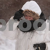 Kyle Bursaw – kbursaw@daily-chronicle.com<br /> <br /> Tina Berg, an NIU employee, pulls down her hood to shield her face from the snow and wind on the NIU campus on Tuesday, Feb. 1, 2011.