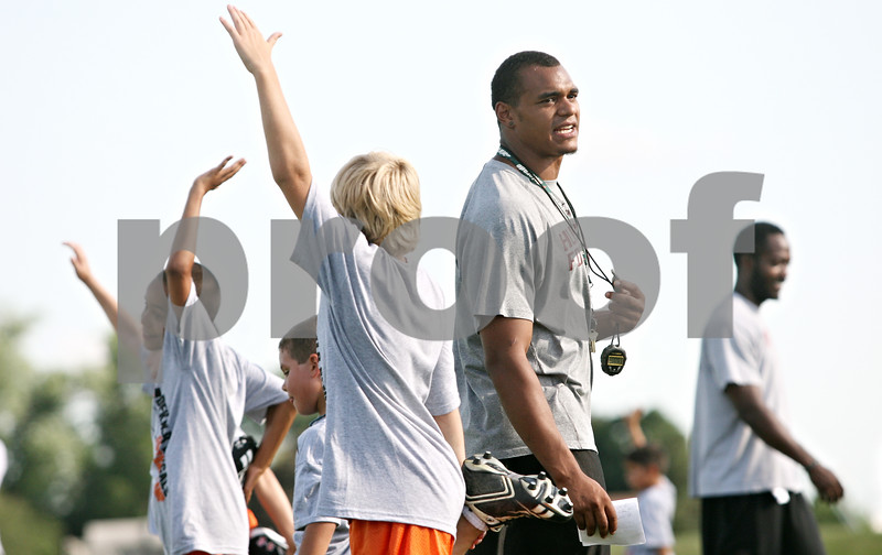 Rob Winner – rwinner@daily-chronicle.com<br /> <br /> Former Northern Illinois University linebacker Alex Kube helps supervise during the DeKalb Bengals Football Camp in DeKalb on Monday evening.
