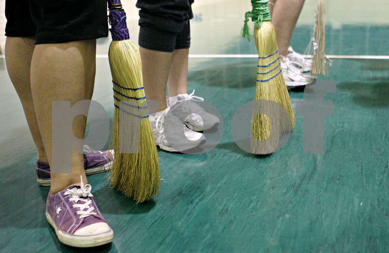 Rob Winner – rwinner@shawmedia.com<br /> <br /> With their brooms ready, the Northern Illinois University Quidditch team prepares for a practice game at the Chick Evans Field House in DeKalb, Ill., on Wednesday, Sept. 21, 2011.