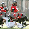 Rob Winner – rwinner@shawmedia.com<br /> <br /> Eastern Michigan quarterback Alex Gillett (8) is tackled by Northern Illinois defensive end Jason Meehan (49) and cornerback Rashaan Melvin (11) after a nine yard gain during the third quarter in DeKalb, Ill., on Friday, Nov. 25, 2011. Northern Illinois defeated Eastern Michigan, 18-12.