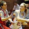 Rob Winner – rwinner@daily-chronicle.com<br /> <br /> Yorkville's Jordann Dhuse (left) pressures DeKalb's Alex Bailey during the first quarter of their game in DeKalb, Ill. on Tuesday, Jan. 18, 2011.