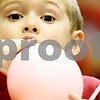 Rob Winner – rwinner@daily-chronicle.com<br /> <br /> Benjamin Neal, 5, of DeKalb, blows up a balloon while learning about lungs during the fourth annual DeKalb School District Family Wellness Fair at DeKalb High School on Thursday night.