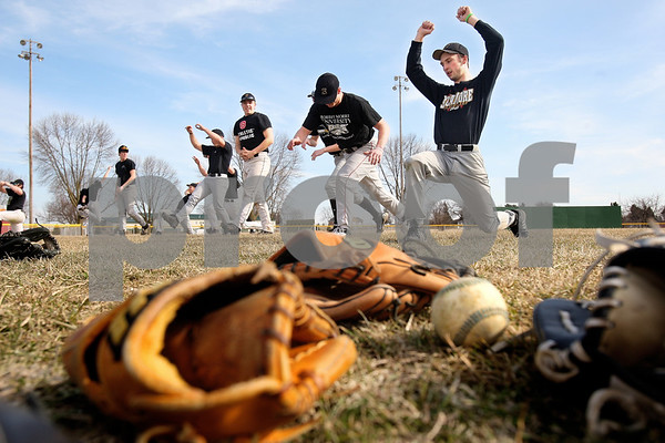 Kyle Bursaw – kbursaw@daily-chronicle.com<br /> <br /> Sycamore baseball players do warm ups  at the start of baseball practice on Wednesday, March 16, 2011.