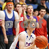 Rob Winner – rwinner@daily-chronicle.com<br /> <br /> Genoa-Kingston's Andrew Oplt sets himself before sinking a three during the second quarter in Genoa, Ill. on Tuesday, Jan. 11, 2011. The Cogs went on to defeat the Cardinals, 49-44.