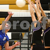 Kyle Bursaw – kbursaw@shawmedia.com<br /> <br /> Genoa-Kingston middle blocker Jordan Rich launches the ball over the net as Hampshire players Michelle Dumoulin and Arianna Rominski attempt to block during their Class 3A Regional Quarterfinal match at Sycamore High School on Monday, Oct. 24, 2011.