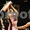 Rob Winner – rwinner@daily-chronicle.com<br /> <br /> Western Michigan center Matt Stainbrook tries to block a shot by Northern Illinois forward Lee Fisher during the first half on Tuesday, Feb. 15, 2011 in DeKalb, Ill.