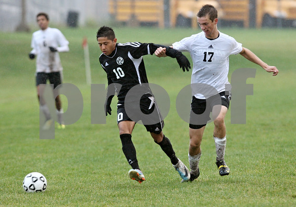 Rob Winner – rwinner@shawmedia.com<br /> <br /> Kaneland's Jordan Escobedo (10) and Sycamore's Dylan Schmidt try to control a ball during the second half in Sycamore, Ill., on Tuesday, Sept. 27, 2011. Kaneland defeated Sycamore, 2-0.