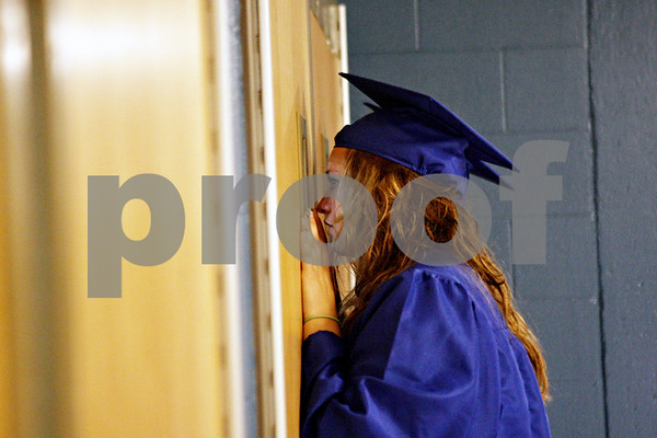 Rob Winner – rwinner@daily-chronicle.com<br /> <br /> Tabitha Ramsey takes a peek inside the gymnasium as friends and family gather before the  start of Genoa-Kingston's commencement ceremony on Wednesday night in Genoa.
