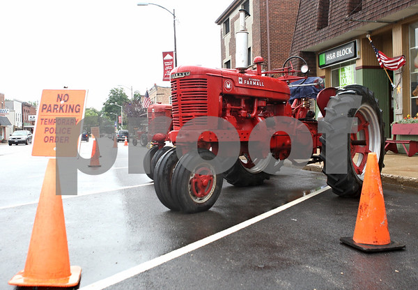 Rob Winner – rwinner@daily-chronicle.com<br /> <br /> Tractors begin lining up in downtown Genoa as Summer Farm Fest got started on Saturday morning.