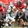 Kyle Bursaw – kbursaw@shawmedia.com<br /> <br /> Northern Illinois quarterback Jordan Lynch (6) finds a lane in the second quarter of the game against Cal Poly at Huskie Stadium in DeKalb, Ill. on Saturday, Sept. 24, 2011.