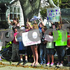 Neighbors stand in front of the Newman family home Friday to raise funds for the family who lost their home to a fire earlier this week. The group has raised $900 since Thursday afternoon.<br /> <br /> By NICOLE WESKERNA - nweskerna@shawmedia.com