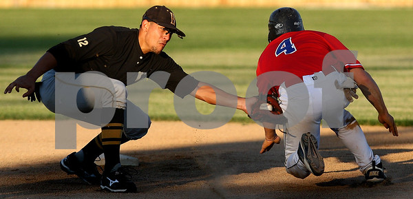Kyle Bursaw – kbursaw@daily-chronicle.com<br /> <br /> Hannibal Caveman player Ray Fuentes reaches out to tag Anthony Foulk (4) of the Liners as he slides to second base. Foulk was ruled safe.<br /> <br /> Saturday, July 2, 2011.