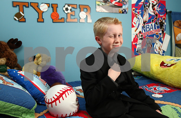 Kyle Bursaw – kbursaw@shawmedia.com<br /> <br /> Tyler Madden, 10, imitates character Barney Stinson in his bedroom in Sycamore. Tyler recently received a signed picture of Neil Patrick Harris, who plays Stinson on the sitcom 'How I Met Your Mother' and was recognized by Harris on 'LIVE! with Kelly' last week. <br /> <br /> Wednesday, Dec. 7, 2011.