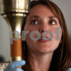 Kyle Bursaw – kbursaw@shawmedia.com<br /> <br /> Michelle Donahoe, Sycamore History Museum's executive director, shows a  1984 Olympic torch made at Turner in Sycamore, one of 5,000 to the audience at the museum's brown bag lunch on Thursday, Oct. 6, 2011. The torch will be part of the museum's upcoming exhibit 'Why Sycamore Works.'