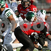 Rob Winner – rwinner@shawmedia.com<br /> <br /> Northern Illinois cornerback Jhony Faustin (28) tackles Eastern Michigan running back Dominique Sherrer (25) after a two yard rush during the fourth quarter in DeKalb, Ill., on Friday, Nov. 25, 2011. Northern Illinois defeated Eastern Michigan, 18-12.