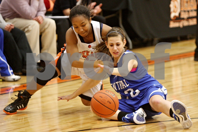 Rob Winner – rwinner@shawmedia.com<br /> <br /> DeKalb's Courtney Patrick (left) and Central's Catherine Kaynish go after a loose ball during the first quarter in DeKalb, Ill., on Tuesday, Dec. 6, 2011.