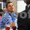 Kyle Bursaw – kbursaw@daily-chronicle.com<br /> <br /> Tom Bastian, a new third grade teacher at Malta Elementary, reacts to a comment made by Superintendent Jim Briscoe during a welcome luncheon for District 428's new teachers and staff at DeKalb High School on Tuesday, Aug. 16, 2011.