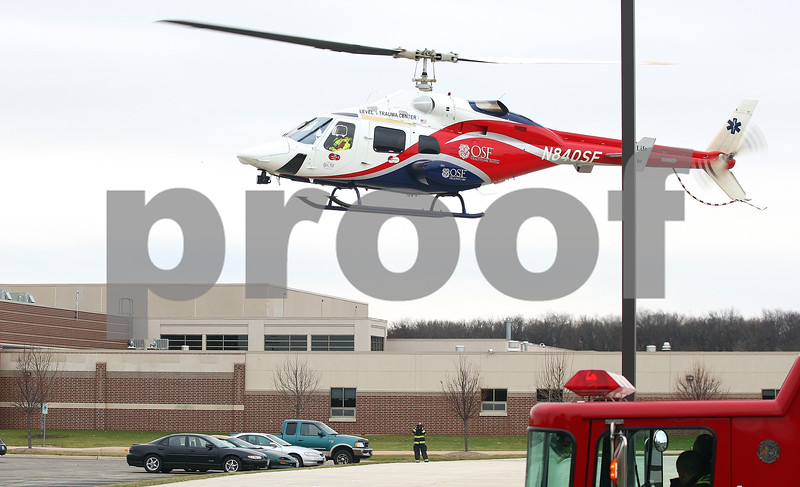Kyle Bursaw – kbursaw@shawmedia.com<br /> <br /> A rescue helicopter takes off from the parking lot of Genoa-Kingston High School on Tuesday, Dec. 6, 2011 after responding to an accident at the railroad tracks across the street from the high school.