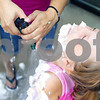 Kyle Bursaw – kbursaw@daily-chronicle.com<br /> <br /> Toni Leal, a social worker with Community Coordinated Child Care, hoses shaving cream off of Reagan Vander Bleek, 6, outside the DeKalb Public Library during the Silly Summer Fun event on Wednesday, Aug. 3, 2011.