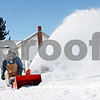 "Rob Winner – rwinner@daily-chronicle.com<br /> <br /> Bill Griffith uses a snow blower to clear a sidewalk near Comanche Avenue in Shabbona on Thursday afternoon. ""I hate to see the kids more in the street than they have to,"" said Griffith as he cleared a path for school children."