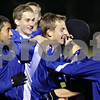 Rob Winner – rwinner@daily-chronicle.com<br /> <br /> Billy Weissinger (center) is congratulated by his Hinckley-Big Rock teammates after the Royals defeated Earlville Leland, 2-1, to become the Class 1A Hinckley-Big Rock Sectional champs. Weissinger scored the winning goal with 3:38 left in the game.