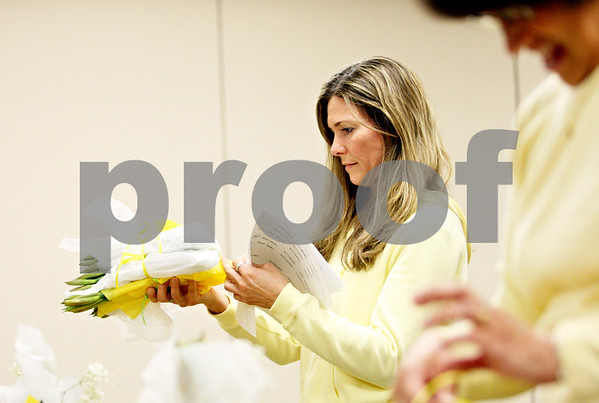 Rob Winner – rwinner@daily-chronicle.com<br /> <br /> At Kishwaukee Community Hospital in DeKalb on Monday morning, volunteer Kelli Liebl, of DeKalb, puts together an order of daffodil flowers that will be distributed to patients during the American Cancer Society Daffodil Days program.