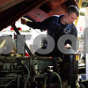 Kyle Bursaw – kbursaw@shawmedia.com<br /> <br /> During a routine maintenance check, DeKalb Firefighter Jim Ruhl checks fluid levels on a ten-year-old fire truck at DeKalb Fire Station no. 1 on Monday, Oct. 31, 2011.
