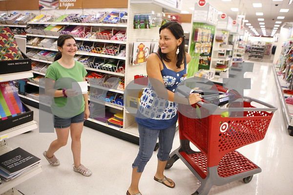 Kyle Bursaw – kbursaw@daily-chronicle.com<br /> <br /> Huntley Middle School student Serene Warren, 13, searches for things on her school supply list at Target with the help of Salvation Army volunteer Carol Orrego (right). Ten students were given an $85 gift card to shop for school supplies with on Tuesday, July 26, 2011.