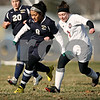 Rob Winner – rwinner@daily-chronicle.com<br /> <br /> Hiawatha's Diana Ascencio (8) moves a ball ahead of Indian Creek's Alexandria Corniveau during the second half of their game in Waterman, Ill., on Thursday, March 24, 2011. Hiawatha defeated Indian Creek, 3-1.
