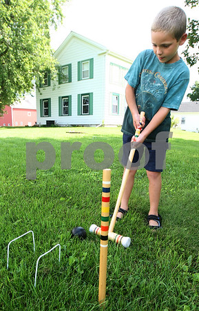 Kyle Bursaw – kbursaw@daily-chronicle.com<br /> <br /> Drew Donahoe plays croquet on the lawn of the Sycamore History Museum during its Family Fun Day event on Saturday, Aug. 13, 2011.