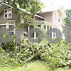 Rob Winner – rwinner@daily-chronicle.com<br /> <br /> Tree limbs litter the front yard of a house located on the 200 block of North Cedar Street in Waterman on Monday afternoon after a storm passed through DeKalb county earlier in the day.