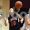Rob Winner – rwinner@daily-chronicle.com<br /> <br /> Indian Creek's Kate Thuestad (20) has the ball knocked away by Somonauk's Lauren Brummel (right) during the first quarter of their Little Ten Conference tournament game on Monday night. Somonauk went on to defeat Indian Creek, 37-26.