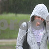 Kyle Bursaw – kbursaw@daily-chronicle.com<br /> <br /> Jeni Camery uses her sweatshirt to shield herself from the rain on the NIU campus in DeKalb, Ill. on Friday, May 13, 2011.