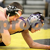Kyle Bursaw – kbursaw@daily-chronicle.com<br /> <br /> Sycamore's Kyle Akins wraps up Dixon's Austin Rhodenbaugh  at Sycamore High School on Saturday, Feb. 5, 2011. Akins defeated Rhodenbaugh to take first place at 112 pounds in the regional tournament.